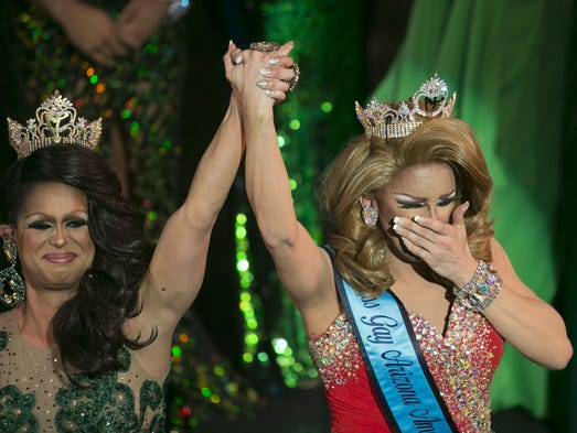 2015 Miss Gay Arizona Nevaeh McKenzie (L) lifts the