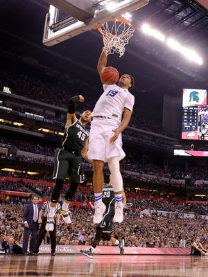 Duke Blue Devils center Jahlil Okafor (15) dunks the ball over Michigan State Spartans guard Denzel Valentine (45) in the second half of their game. The 2015 NCAA Final Four semi finals feature Duke against Michigan State and Wisconsin versus Kentucky Saturday, April 4, 2015, evening at Lucas Oil Stadium.