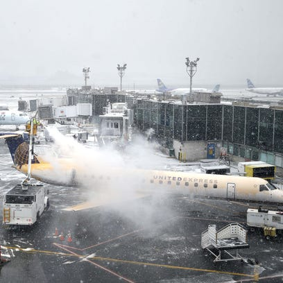 Aircraft are de-iced on the runway at LaGuardia Airport