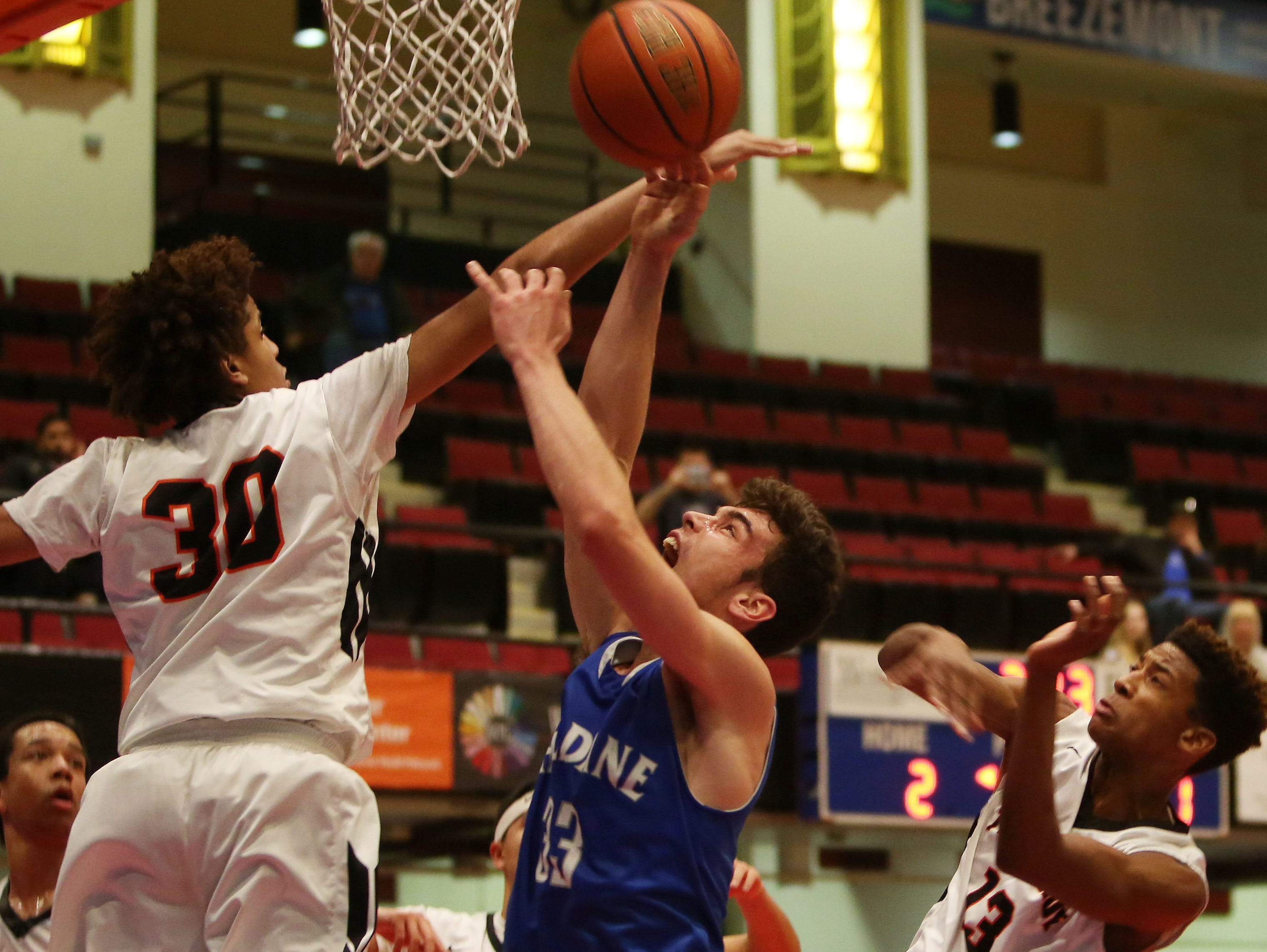 Haldane's Will Zuvic (33) is fouled by Tuckahoe's Bryan Murray (30) as he goes up for a shot during first half action in the boys Class C semifinal at the Westchester County Center in White Plains Feb. 24, 2016. Haldane won the game 44-34.