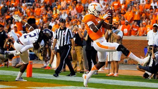 Preston Williams catches a touchdown pass for Tennessee during a 2015 win over Western Carolina. Williams transferred to CSU over the winter to play football for the Rams but also is competing on school's track and field team in the long jump.