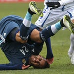 LANDOVER, MD - MARCH 28: Roberto Pereyra #24 of Argentina is tripped up against El Salvador in the first half during an International Friendly at FedExField on March 28, 2015 in Landover, Maryland. Argentina won, 2-0. (Photo by Patrick Smith/Getty Images) ORG XMIT: 543176799 ORIG FILE ID: 467937302