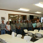 Employees and friends recently gather at Crop Production Services to celebrate the company's environmental award.