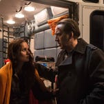 """Sarah Wayne Callies and Nicolas Cage in """"Pay the Ghost."""""""
