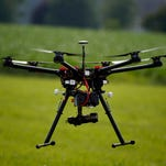 A hexacopter drone flies June 11, 2015, during a drone demonstration at a farm in Cordova, Md.