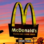 """In this Saturday, Oct. 10, 2015, photo, the sun sets behind a McDonald's in Ebensburg, Pa. McDonald's hopes it has a catchy, new deal that will be as hugely popular as its Dollar Menu. Starting Jan. 4, 2016, the fast-food chain will launch the """"McPick 2"""" menu, which will let customers pick two of the following items for $2: a McDouble, a McChicken, small fries and mozzarella sticks."""