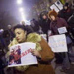 Demonstrators protesting the shooting death of Ronald Johnson rally in the Washington Park neighborhood on December 7, 2015 in Chicago, Illinois. Police say Johnson had a gun in his hand when he was shot; Johnson's family and their attorney dispute this claim.