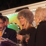 "At left Palm Springs Mayor Robert Moon and Suzanne Somers toast to the one year anniversary of the ""Buzz"" bus in downtown Palm Springs."