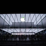 """The """"leaf"""" on the logo of Apple store turns green to welcome the World Earth Day on April 20, 2016 in Hangzhou, Zhejiang Province of China."""