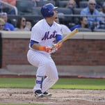 New York Mets' Michael Conforto (30) follows turing on an hits an RBI double during the second inning of a baseball game against the San Francisco Giants Saturday, April 30, 2016, in New York. (AP Photo/Frank Franklin II)