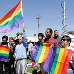 """Students rally outside Santee Education Complex in South Los Angeles on Wednesday, April 20, 2016. The principal of the Los Angeles high school where a scuffle broke out with adult protesters over a new gender-neutral bathroom praised his students Wednesday as """"trailblazers"""" for campaigning to install the restroom. Bathrooms for transgender students have become a focal point in the national debate over anti-discrimination laws."""