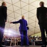 Hillary Clinton speaks at a June 1 Newark rally as singer Jon Bon Jovi and New Jersey Sen. Cory Booker look on.