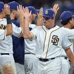 Renfroe homers off roof of brick warehouse in Padres' win
