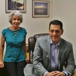 Carol Hess and Stan Grigiski in his office at Medical Claim Service of Southwest Florida Inc.