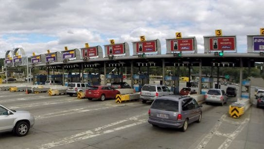Cars pull into the toll booths in Tarrytown after crossing