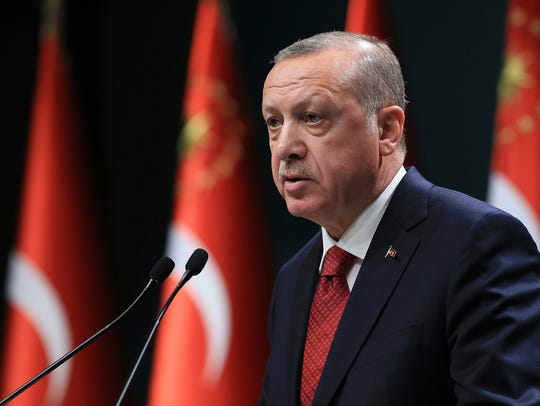 Turkey's President Recep Tayyip Erdogan announces early presidential and parliamentary elections for June 24 at the Presidential Palace, in Ankara, Turkey, April 18. Elections were originally scheduled for November 2019 and the new date is expected to help Erdogan consolidate his power.