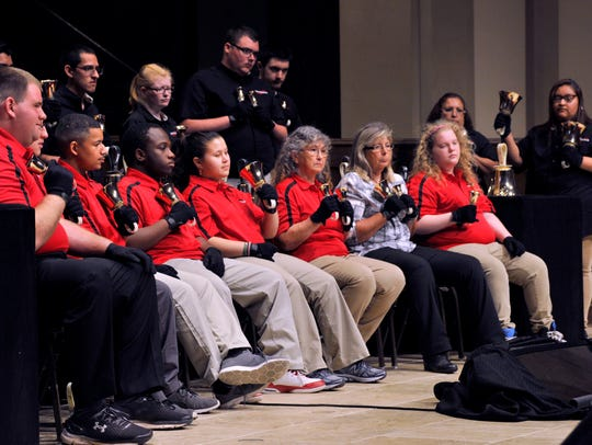 Members of Soundwave, the Abilene ISD handbell choir, perform at First Baptist Church Tuesday. This is the 40th year for the choir which teaches special needs students how to play music.