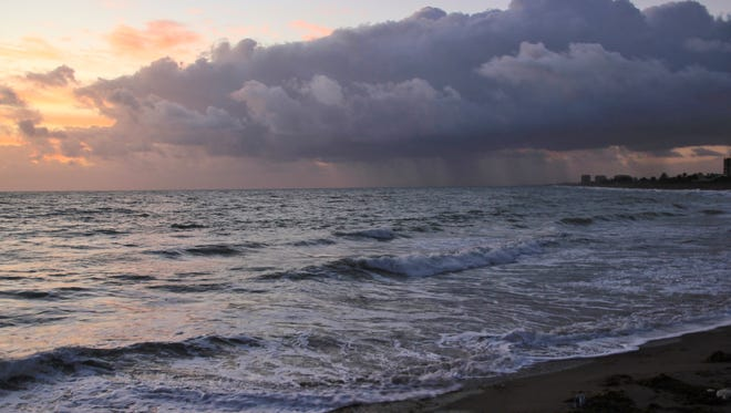 Terrie Selph took this photo of a cloudy sunrise with a rain storm moving in off the ocean at the south jetty on Dec. 27 in Fort Pierce.