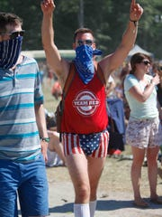 Fans enjoy Weezer as they play at the Firefly Main Stage on the final day of Firefly Music Festival at The Woodlands in Dover Sunday June 22, 2014.