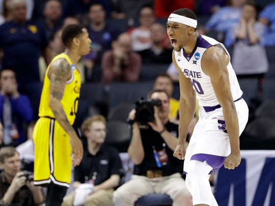 Kansas State's Xavier Sneed celebrates after a dunk