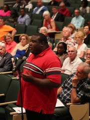 A man asked a question to the panel during The News-Press Town Hall at Dunbar High School.