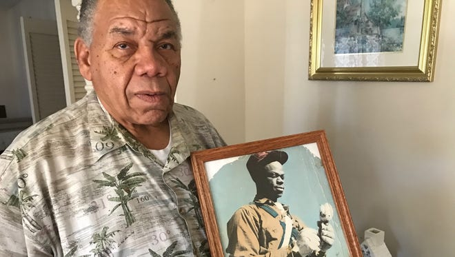 Nelson Wilson Jr. shows a photograph of his father, who owned land in Fisher County and grew cotton before moving to Abilene after the 1950s drought.