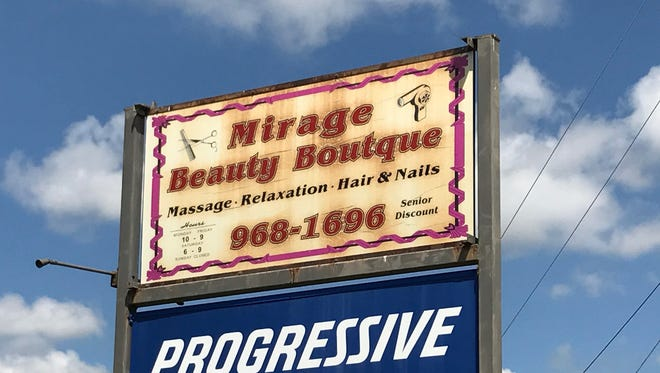 The sign at Mirage Beauty Boutique