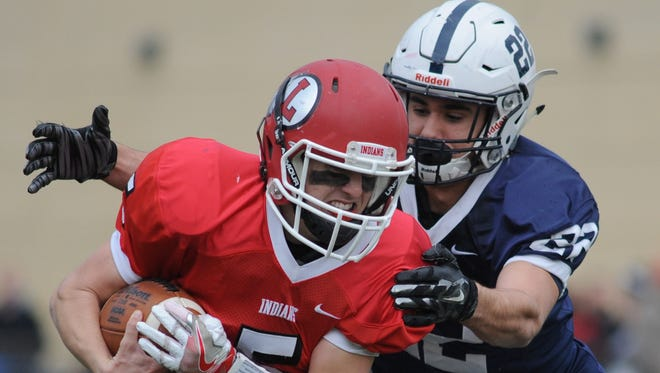 Shawnee's Ryan Parris tackles Lenape's Matt Lajoie during the teams' Thanksgiving football game last year.