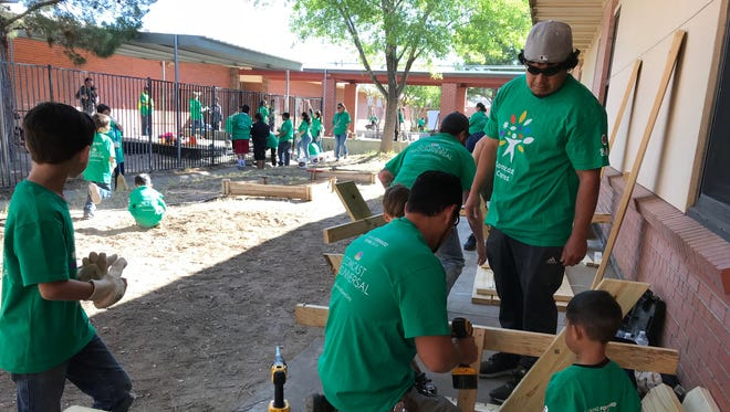 As part of Comcast Cares Day, more than 1,000 volunteers worked at Hermosa Heights Elementary School to beautify the school campus.