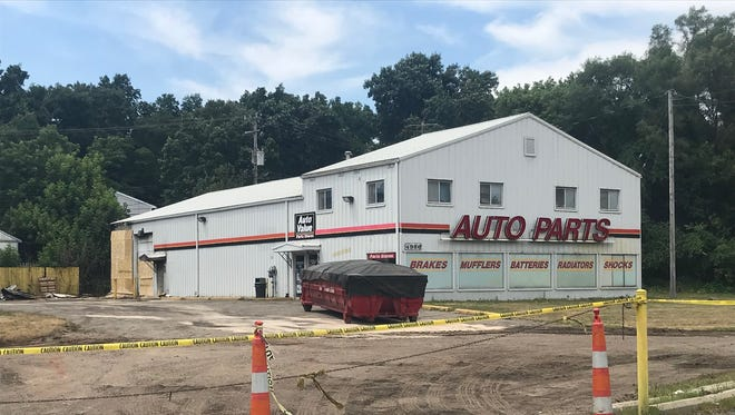 The Auto Value store along Old U.S. 23 is closed after a fire started in the rear of the building Wednesday June 11, 2018.