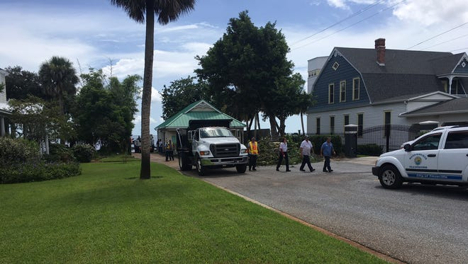 Scene near Indian River Drive and South Street where crews work to clean up sewage spill.