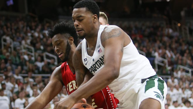 Xavier Tillman rebounds against Ferris State's Markese Mayfield during the second half of MSU's 80-72 exhibition win Thursday.