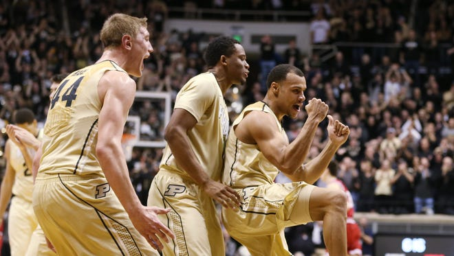 Purdue center Isaac Haas (left), forward Basil Smotherman (center) and teammate Bryson Scott (right) celebrate taking a big lead over Indiana in the first half, Jan. 28, 2015.