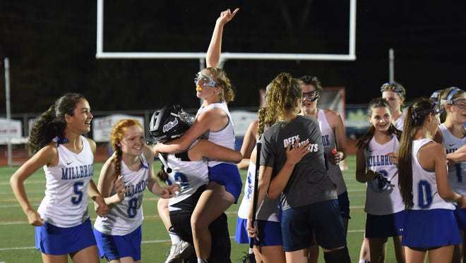 Millbrook's girls lacrosse team celebrate their win over O'neill on Wednesday's Section 9 Class C final at Dietz Stadium in Kingston.