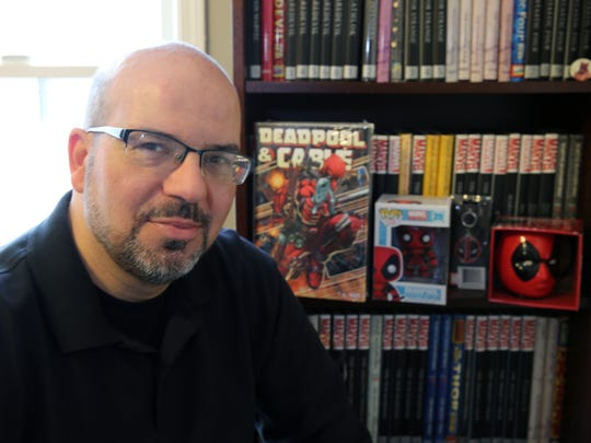 Fabian Nicieza, comic book writer and co-creator of the Marvel character Deadpool who will be brought to life on the big screen with Ryan Reynolds playing the titular role is photographed in his home in Princeton Junction on Thursday January 14, 2015.