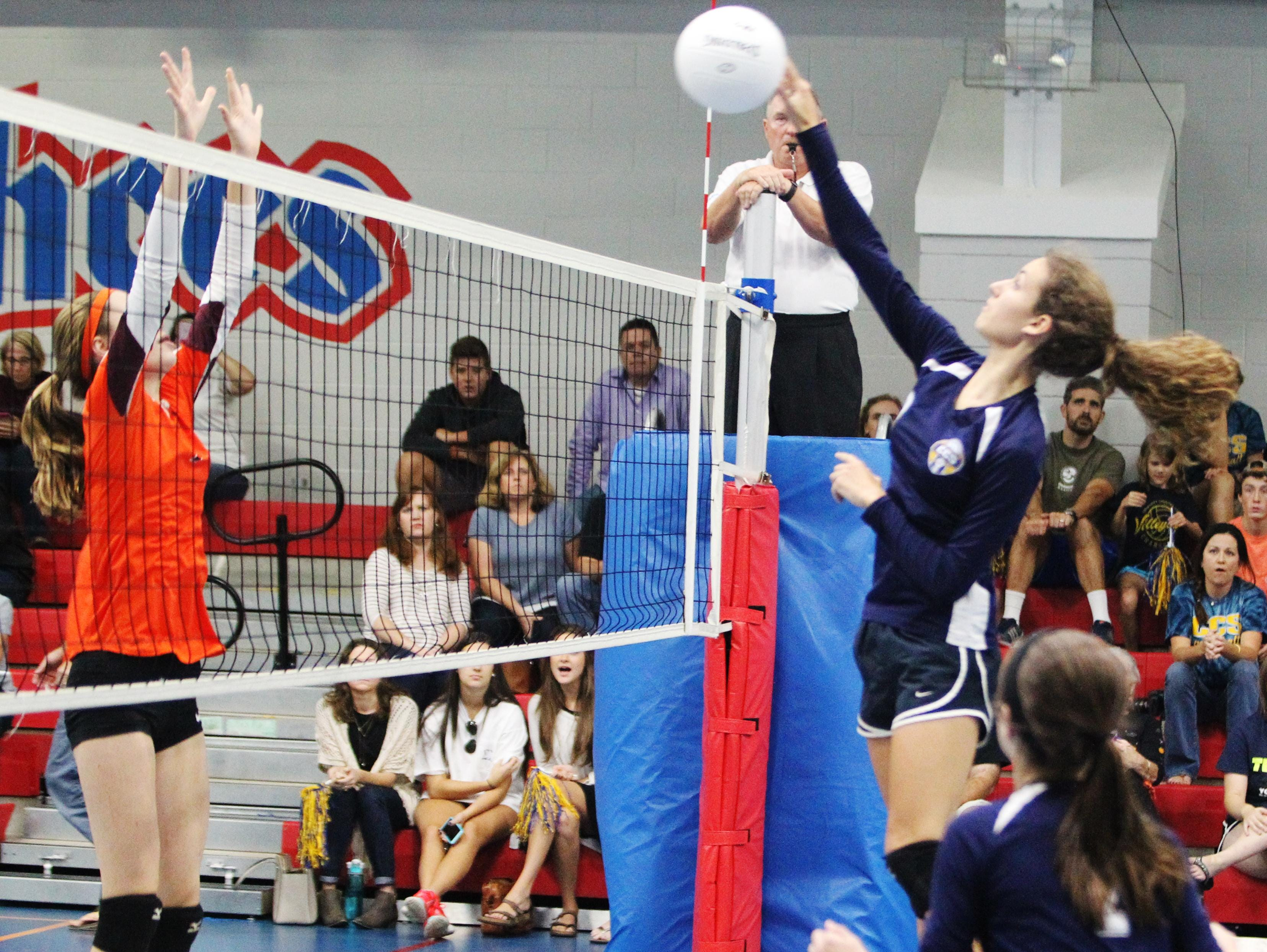 Community Christian School senior Amanda Post leaps to spike the ball in Wednesday's match against Christ's Church Academy.