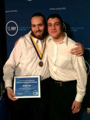Brothers Abraham, left, and Mendel Taub at the SUNY Chancellor's Award ceremony for Abraham in 2012