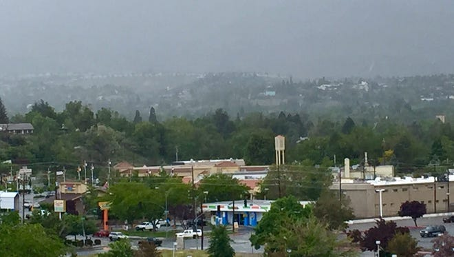 Clouds and rain hover over West Reno on Tuesday, May 24, 2016.