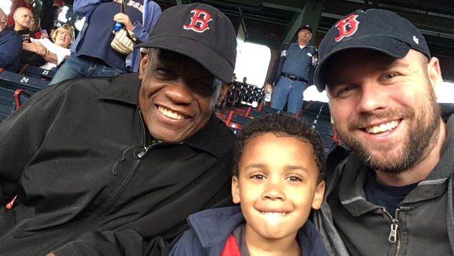 Guy Mont-Louis, Nile and Calvin Hennicks at Fenway Park on Tuesday night.