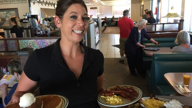 Busy server on Sunday morning at Humble Joe's Chop House & Grill in Anderson.