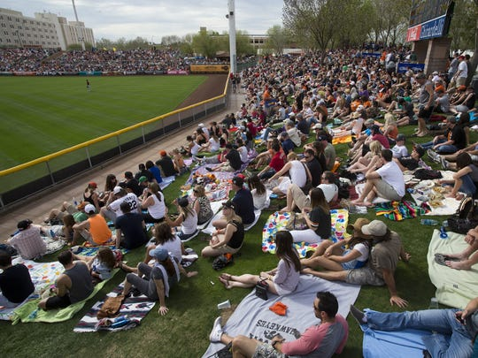 Fans fill the  lawn at Scottsdale Stadium, spring home