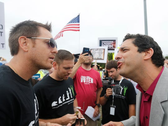 Jake Macaulay, left, argued with David Silverman, then-President of American Atheists, over religion on the side of a highway near the Ark Encounter. July 6, 2016