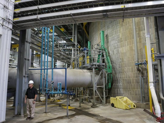 LG&E and KU Energy VP of transmission and generations services, John Voyles, stands near the updated scrubbers at the Mill Creek Generation Station, on  Aug. 18, 2016. The utility has invested $2.8 bllion in emission controls since 2011.
