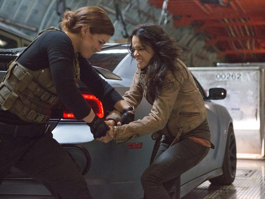 """Boys, get out the way: Gina Carano and Michelle Rodriguez tussle in """"Fast & Furious 6."""""""
