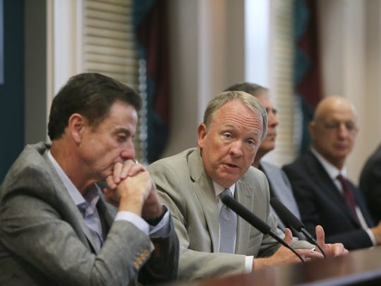 Interim President Greg Postel speaks during a press conference to address the NCAA penalties in June 2017. Former men's basketball coach Rick Pitino sits on the left, while former Athletic Director Tom Jurich and consultant Church Smrt are seen on the right.
