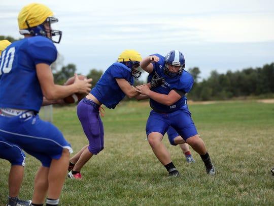 West Liberty junior Spencer Daufeldt goes over players
