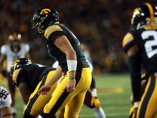 Iowa quarterback Nate Stanley calls to players during
