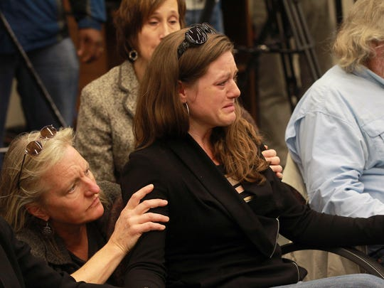 Harmony Hauser, Jonathan Wieseler's fiancee, listens as Johnson County Attorney Janet Lyness discusses Wieseler's death during a conference at City Hall on Monday, Nov. 20, 2017. Curtis Jones, who is already charged with first-degree murder in the death of cab driver Ricky Lillie, has now been charged with first-degree murder in the death of Wieseler.