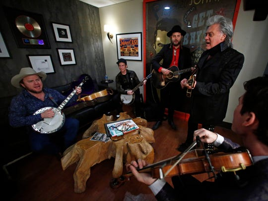 Old Crow Medicine Show members are seen backstage with