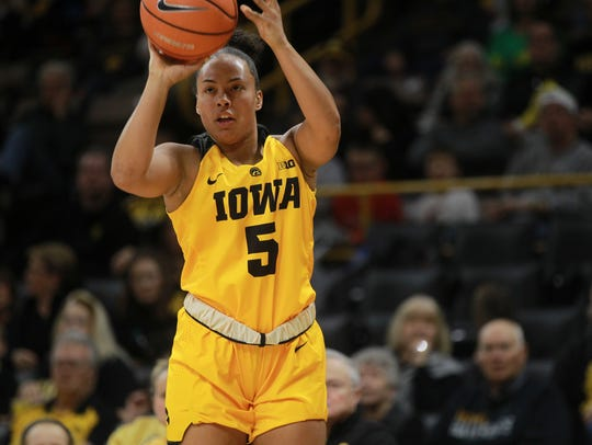 Iowa's Alexis Sevillian shoots a 3-pointer during the